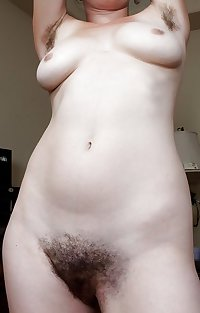 mature spreading and showing hairy pussy